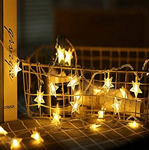 Solar Star Stringing Lights for a Movie Viewing Party